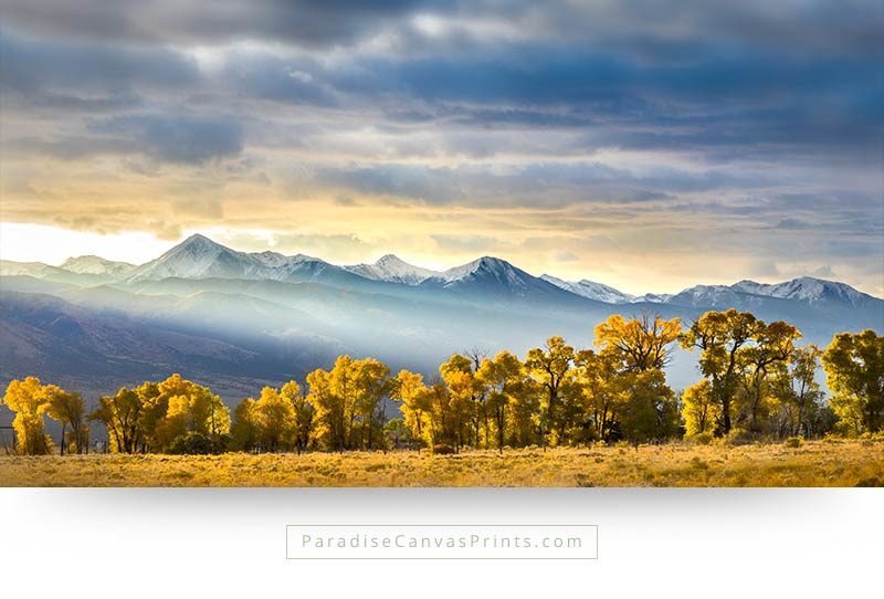 Colorado wall art print of a beautiful sunrise over mountains, with trees in the foreground