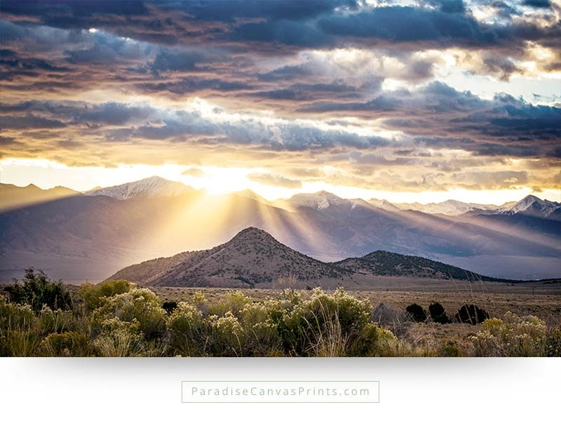 Colorado wall art showing sunrise over the mountains with dramatic clouds