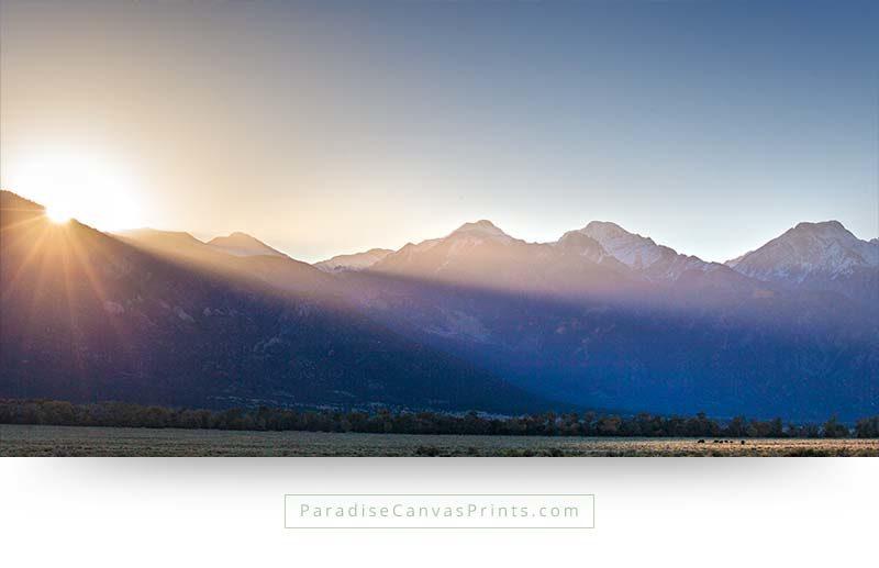 The sun rises over cold mountain peaks in Colorado